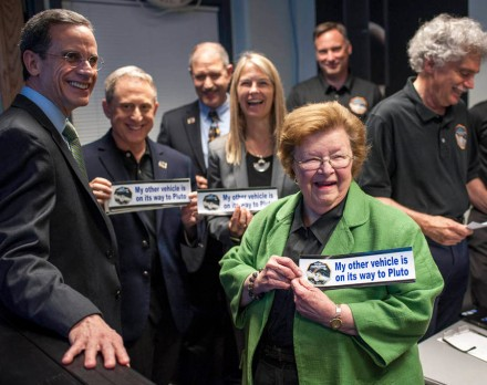 Sen. Barbara Mikulski, D-Md. holds a bumper sticker given to her by members of the New Horizons team at the Johns Hopkins University Applied Physics Laboratory (APL) Monday, July 13, 2015 at APL in Laurel, Maryland. Also in the photograph are: Johns Hopkins University Applied Physics Laboratory (APL) Director Ralph Semmel, left, New Horizons Principal Investigator Alan Stern of Southwest Research Institute (SwRI), Boulder, CO., Associate Administrator for the Science Mission Directorate John Grunsfeld, and NASA Deputy Administrator Dava Newman. Photo Credit: (NASA/Bill Ingalls)
